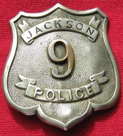 Early Jackson Police badge #9.