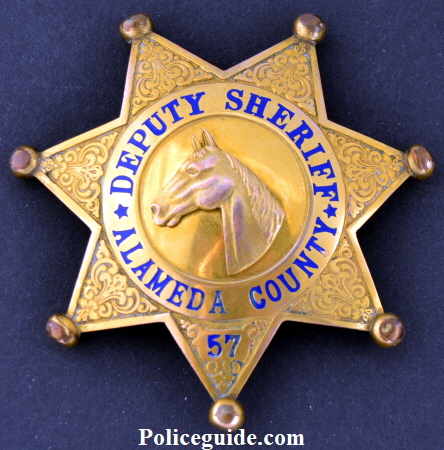 Alameda Co. Deputy Sheriff, gold front, #57 with applied horse head.