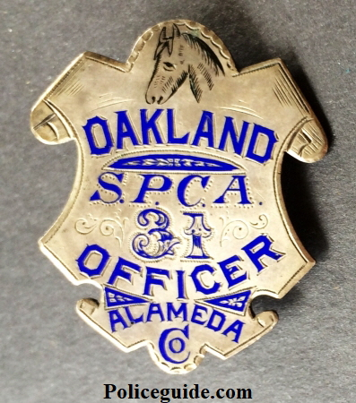Alameda Co. Oakland SPCA Officer, #31, sterling silver, hand engraved. Hallmarked Morton Jeweler Co. Oakland, CA.  George Fake was now working for Morton and you can see his signature enameled engraving.