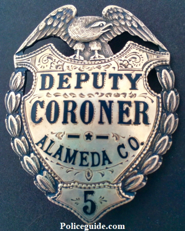 Alameda Co. Deputy Coroner #5, sterling silver, hard fired black enamel and hand engraved.  Made by Ed Jones Co. Oakland, CAL