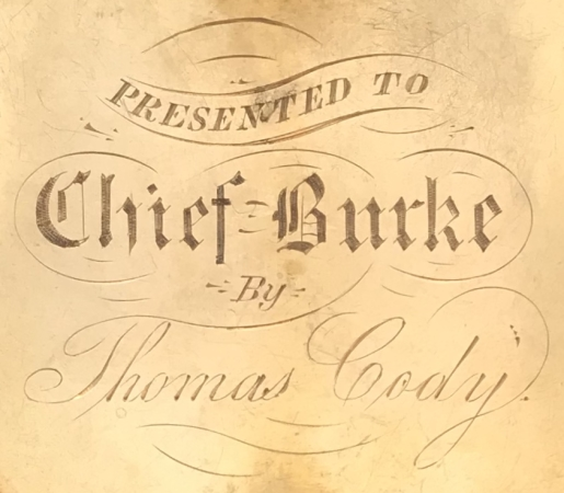 Reverse of Chief Martin Burke's badge showing the presentation.