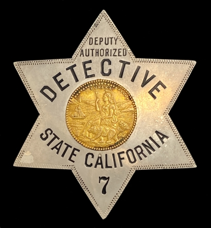 Deputy Authorized Detective State of California badge #7 is made by Irvine & Jachens 1027 Market St. S.F.  This hallmark was used from 1910-1925.  The California Bureau of Investigation (CBI), was established in 1918 as the California Bureau of Criminal Identification and Investigation (CBCII). CBCII, along with the disbanded California Bureau of Narcotic Enforcement (BNE) which was created in 1927 (the remainder of BNE merged with CBI in 2012), provided the state with its initial criminal investigative law enforcement capabilities and is considered the direct predecessor to the modern day CBI.
