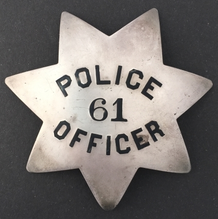 San Francisco Police badge #61 issued to George H. Graham who was appointed on March 22, 1892.  Sterling silver, T-pin back.
