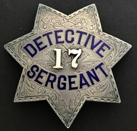Detective Sergeant badge #17 worn by Eugene R. Wall who joined the department on 10/9/1891.  By 1910 he rose to the rank of Captain of Detectives.