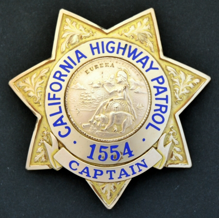 C.H.P. badge #1554 with the rank of Captain.  The badge is Gold Front and the rank panel is riveted to the badge.  This style badge was first worn in 1929 when the modern C.H.P. was formed under the Division of Motor Vehicles, Department of Public Works.