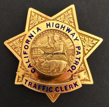 Diminutive but rare, this Traffic Clerk badge is Gold Front with a riveted rank panel, made by  Ed Jones Co. Oakland, CAL.