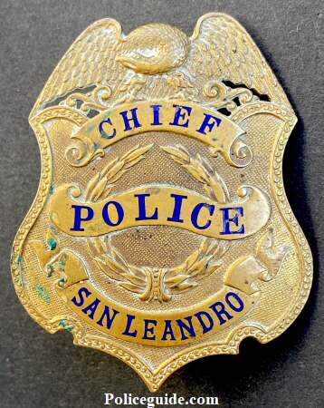 Presentation on reverse reads To J. F. Peralta From Jack Cribbins.  This badge is thought to have been Chief Peralta's first Chief of Police badge.  After the badge to the right was presented to him this badge was used as a hat badge.