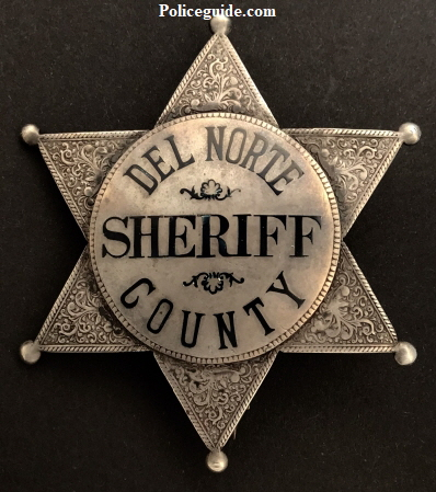 Early Sheriff's badge made of sterling silver with hard fired black enamel.