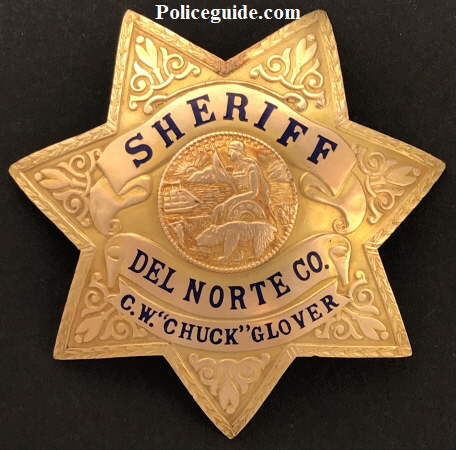 Gold front presentation badge to Del Norte Sheriff Glover.