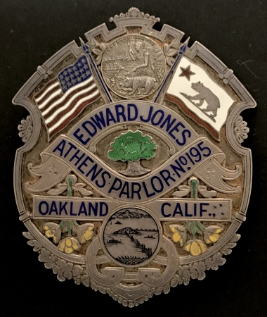 "The personal badge of famed Oakland badge maker Ed Jones. Hallmarked (you guessed it) Ed Jones Oakland Sterling. Pictured in Witherells book California's Best. Ed Jones was a member of the Native Sons of the Golden West, Athens Parlor No. 195. Along with the state seal there is also a scene of the newly constructed Bay Bridge, and the U.S. and State Flags. Left and right of the bridge scene are the state flower, California Golden Poppies done in yellow enamel, representing ""fields of gold"". In the center is an enameled Oak tree for which the city of Oakland is named. After the word Calif., you can see 3 waterfowl taking off. It has a pin and catch and weighs in at 4.84 oz. of sterling."