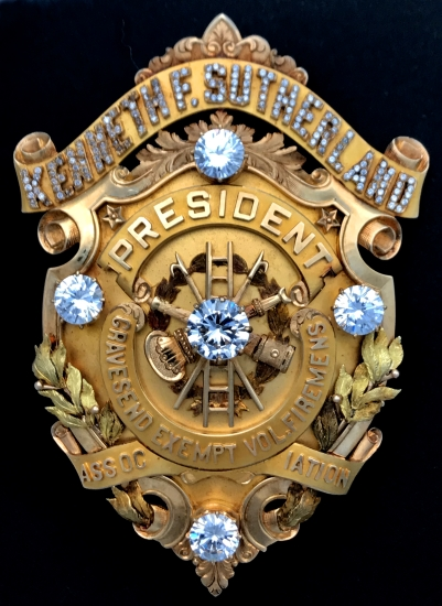 "Kenneth F. Sutherland President Gravesend Exempt Vol. Firemens Association presentation badge.  Hallmarked 14k C. G. Braxmar Co. N.Y.  3 7/8"" tall."