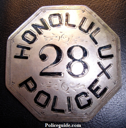 Honolulu Police badge #28.  Sterling silver with hard fired black enamel.