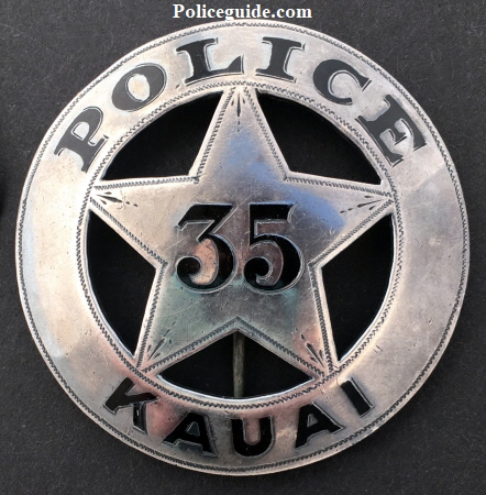 Police badge #35 Kauai.  Sterling silver with hard fired black enamel.