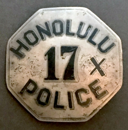 Honolulu Police badge #17 and crossed oars.  Sterling silver with hard fired black enamel.