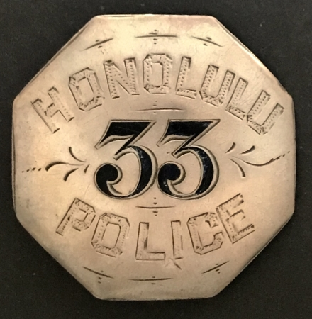 Honolulu Police badge #33, sterling with hard fired black enamel and hand engraved.
