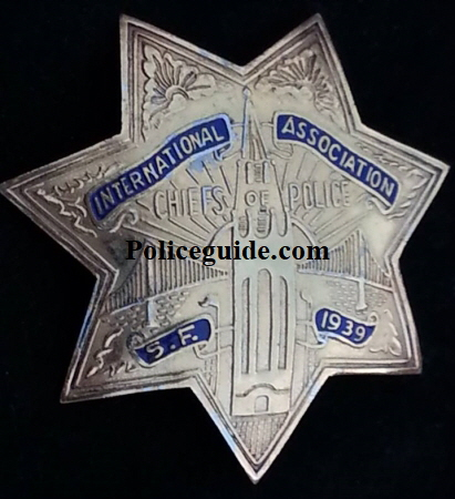 Jim told me that this badge was created from a picture of a much smaller 1/3 size badge that was suspended from a metal ID holder for the the Chiefs of Police convention held in San Francisco in 1939.