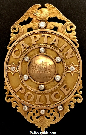 Gold presentation badge, presented to George M. Brown Captain of Police Louisville Police Department.
