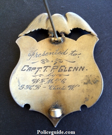 Sterling presentation badge, presented to Captain T. P. Glenn by W.F. Mc G / GHB - Chas. W.