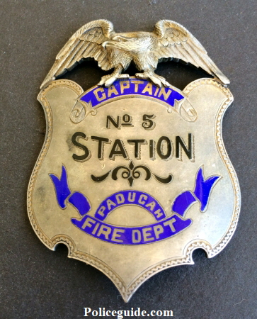 Captain No 5 Station Paducah Fire Dept. sterling silver presentation badge.  Obverse reads Presented to Capt. T. P. Glenn by W. F. Mc C. / G. H. B. - Chas. W.