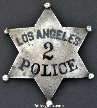 W.C. Roberts' LAPD Series 2 Police badge, made of sterling silver with hard fired black enamel.  Anker & Carson.