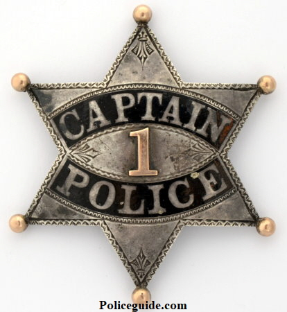 W.C. Roberts' LAPD Series 2 Captain's presentation badge, made of sterling silver with hard fired black enamel, an applied number 1 and hand chased engraving.