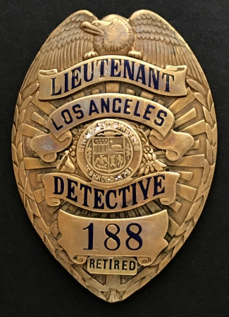 Issued Lieutenant Detective badge #188 with applied RETIRED banner.  Hallmarked Carl Entenmenn JLY Los Angeles, CAL