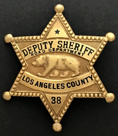 Los Angeles County Deputy Sheriff Road Department badge #38.