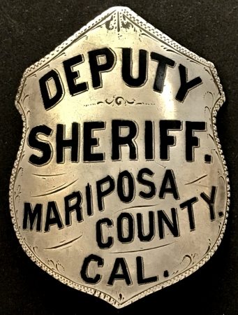 Deputy Sheriff Mariposa County CAL.  Badge is sterling silver with hard fired black enamel.  T-pin and C catch.  Circa 1880.