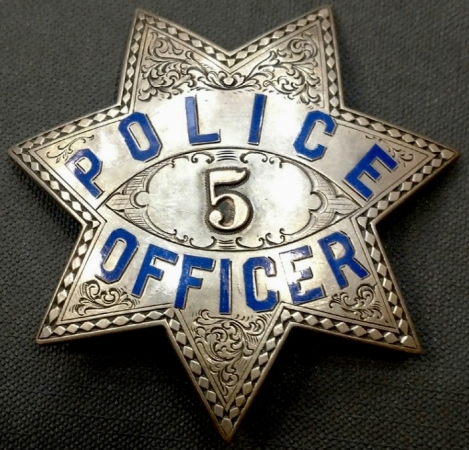 Chico Officer Ed Martin's sterling presentation badge.