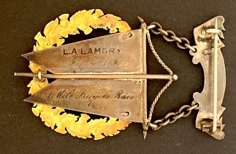 Inscribed on reverse:  L. A. Lamory / July 4, 1891 / 1 Mile Bicycle Race