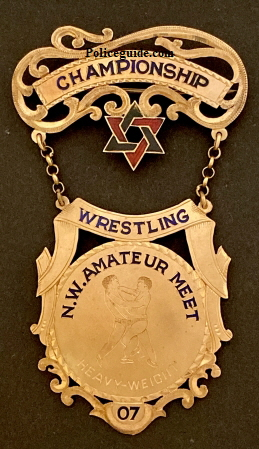 Championship Wrestling N. W. Ameateur Meet / Heavyweight 07.  14k gold.