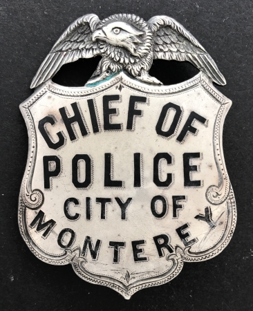 Chief of Police City of Monterey, last worn by Gus England, circa 1910, made of sterling silver, T-pin and C-catch.