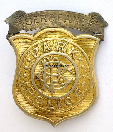 "This Brooklyn Park Police Sergeants badge is an example of the badges worn by the officers patrolling the 526 acre Prospect Park. The park's police force was established in 1866. According to the Brooklyn Daily Eagle its mission was ""to guard the property now on the ground, and hereafter promote the observance of the peace and respect for the improvements when the Park shall become a public resort.""  The original force consisted of nine patrolmen, three sergeants, and a captain.  In the following photo from 195, patrolman John O'Hara warns Donald Boa of the dangers from skating on Prospect Park Lake."