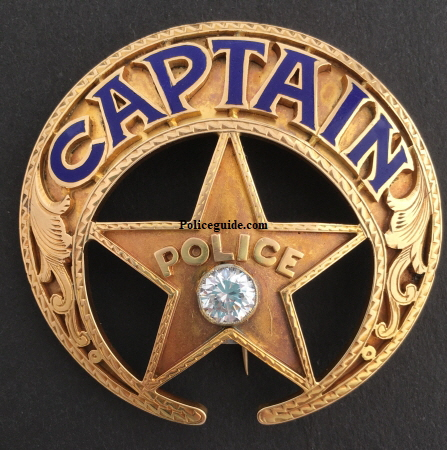 New Orleans Police Detective badge, 14k gold, adorned with a diamond, with hard fired enamel lettering and hand engraved gold inlay designs.