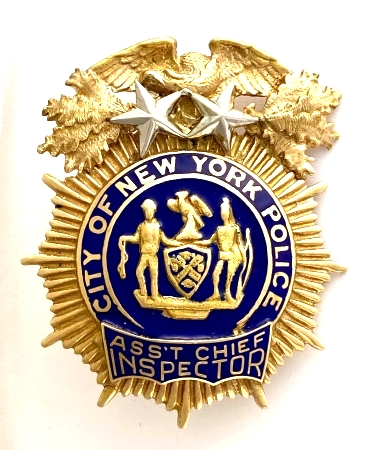 14k Assistant Chief Inspector.  Rank is the same as Assistant Chief (2 Stars). Now a defunct title.