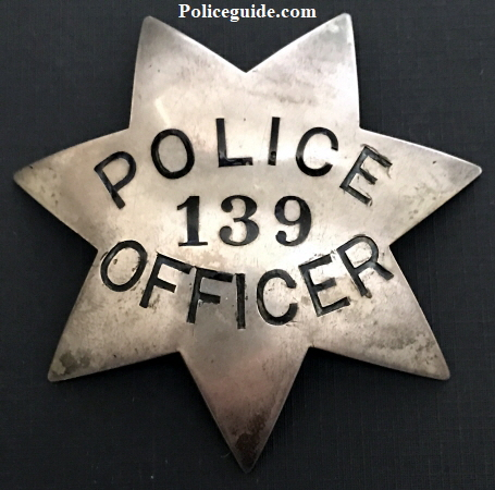 Oakland Police Department badge #139 issued to Edward K. Long on 2-2-12.