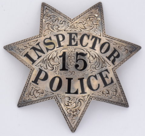 Oakland Police Inspector #15 issued to A. Trotter  who was appointed to the force 1-1-13. Sterling silver, hand engraved with hard fired enamel lettering.