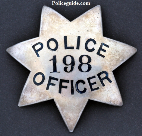 Circa 1915 Oakland Police badge #198 issued to O.G. Engdol.  Below is a photo of Engdol wearing his Sergeant badge.