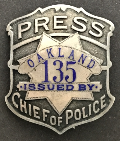 Oakland Press badge #135 issued by Chief of Police.  Sterling silver, made by Ed Jones Co. Oakland, CAL.