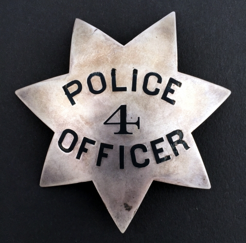 Oakland Police 1st issue badge #4 issued to Officer Adelbert Wilson, circa 1870.  His 14k gold Captain badge is shown below.