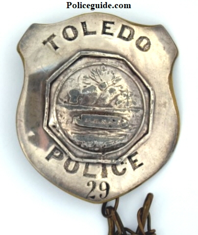 "Second Issue Toledo badge, nicknamed the ""Canal Boat.""  3"" in height,  #29 with chain keeper.  Issued on July 3, 1868."