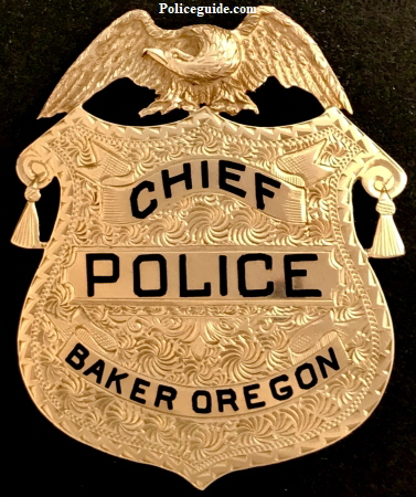 1k gold Baker Oregon Chief of Police badge presented to Walter E. Palmer.