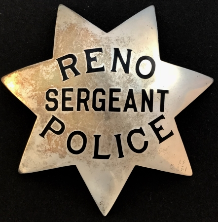 Reno Police Sergeant badge, sterling silver, hard fired black enamel.  Made by Ed Jones & Co. Oakland, CAL.  Circa 1920-1940.