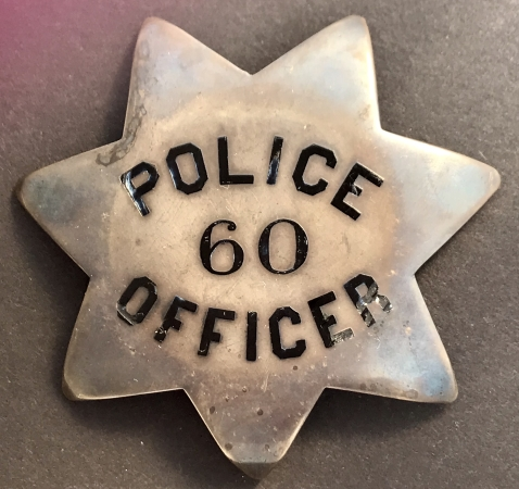 San Francisco Police badge #60 issued to John P. Herlihy who was appointed on Dec. 2, 1895.  Sterling silver, T-pin back.