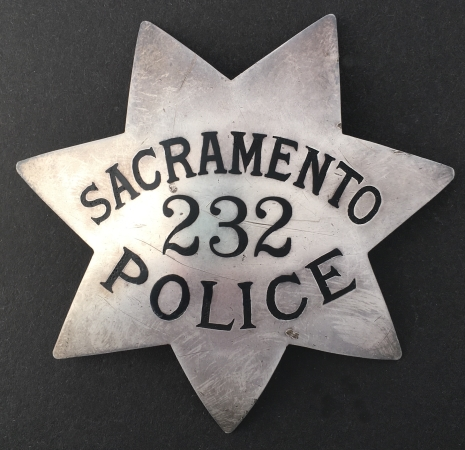 Sacramento Police Badge #232.� Sterling silver, made by Entenmann.  During the 1950�s Entenmann got an order from Sacramento PD for badges.  It was a short lived relationship thus making the Entenmann version somewhat rare.