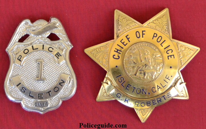 Isleton police badge #1 and Chief of Police badge personalized to G. K. Roberts.