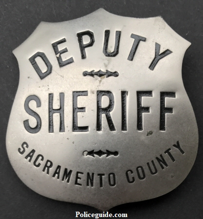 Sacramento Deputy Sheriff badge, nickel shield, hallmarked Ed Jones & Co. circa 1924.