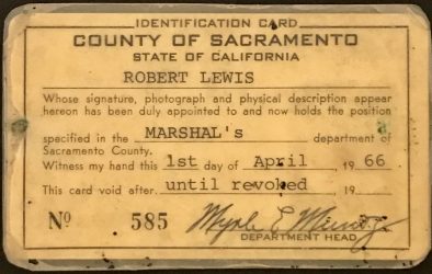 Sacramento County Deputy Marshal badge #22 for Robert Lewis and ID card issued April 1, 1966.