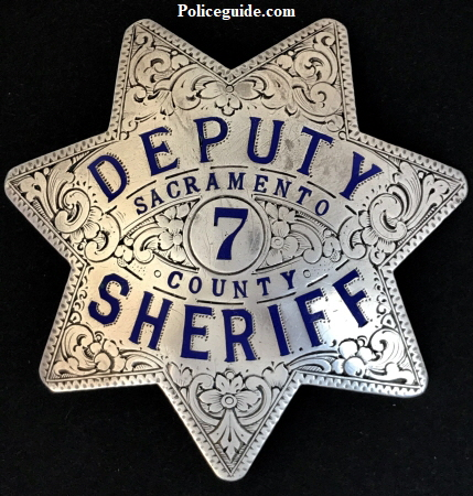 Sacramento Deputy Sheriff badge #7, sterling silver,� hand engraved.� In 1932 the department changed the uniform badge style from a nickle badge to this style.  This badge is from the first order of sterling badges.   Dated 3-7-32.
