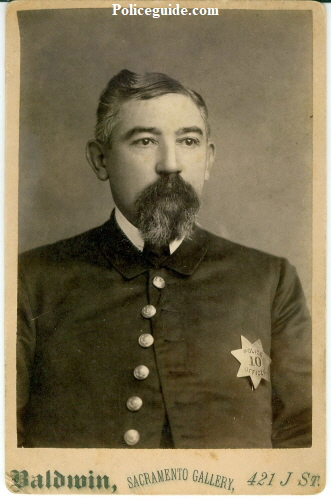 Cabinet photo by Baldwin of Sacramento Police officer William Lowell wearing 1st issue badge number 10.